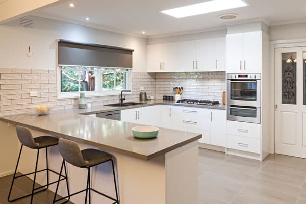 contemporary kitchen with subway tiles splashback