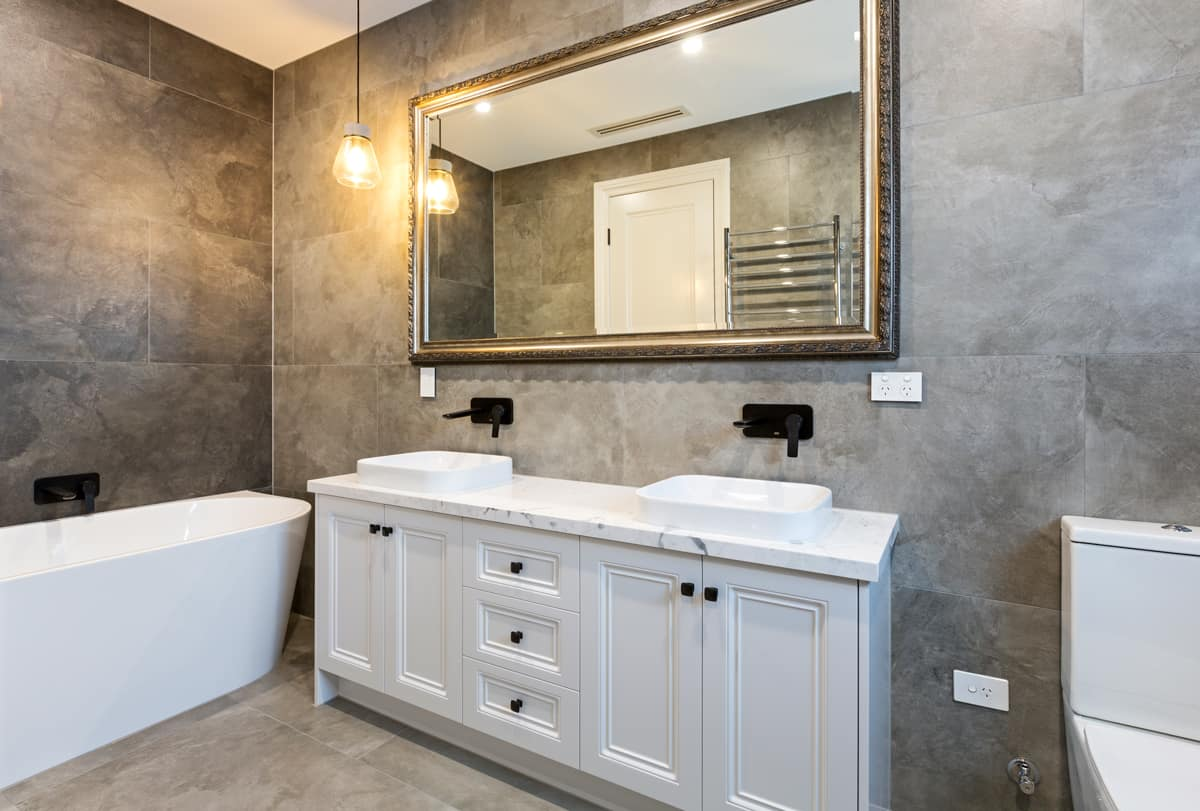 ensuite-bathroom-in-grey-tiles-and-2-pack-white-vanity